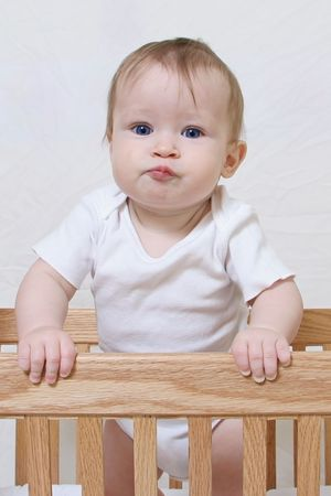 Little Baby Girl in crib Stock Photo - 6791233
