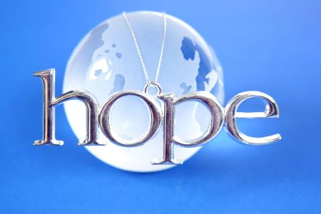 hope: Glass globe with silver HOPE sign on it