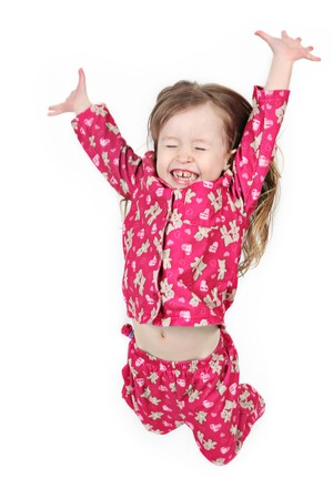 Little girl jumping on isolated white background photo