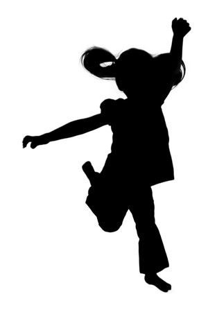 reach: Silhouette of girl jumping up in the air  Stock Photo