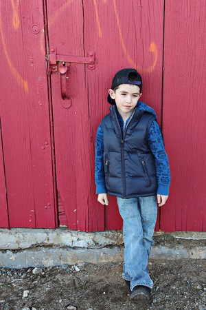 cool guy: Young child hanging out near a grungy wall  Stock Photo
