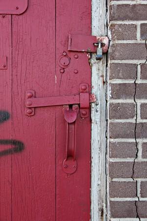 Old Red wooden door in old building photo
