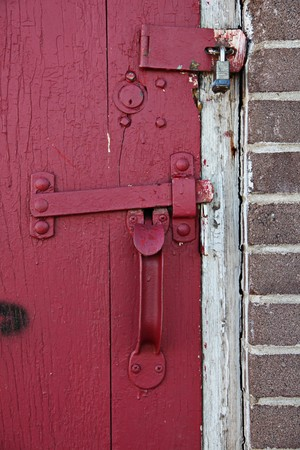 door knob: Old Red wooden door in old building