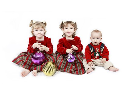 Three Children isolated on white in Christmas outfits Stock Photo - 7186339