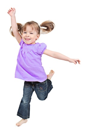 child model: Adorable little girl jumping in air. isolated on white background