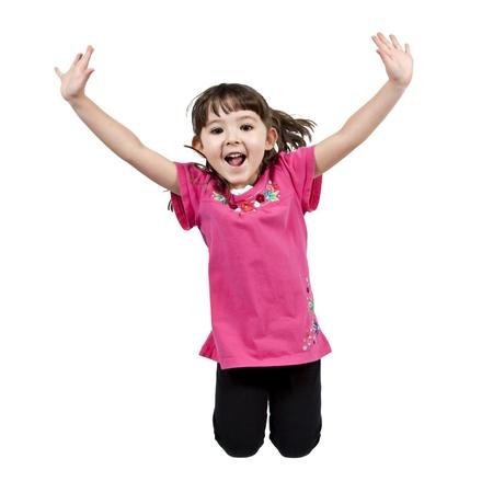 Niña poco adorable y feliz saltando en el aire. aislados en fondo blanco  Foto de archivo - 8951876