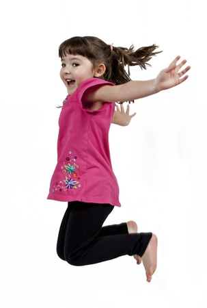 Adorable and happy little girl jumping in air. isolated on white background 스톡 콘텐츠