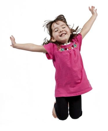 child model: Adorable and happy little girl jumping in air. isolated on white background