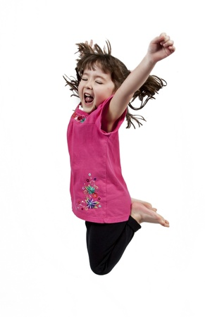 Adorable and happy little girl jumping in air. isolated on white background