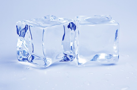 Two ice cubes in blue photo