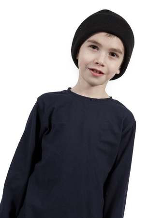 Portrait of a cute little boy with hat on.  photo