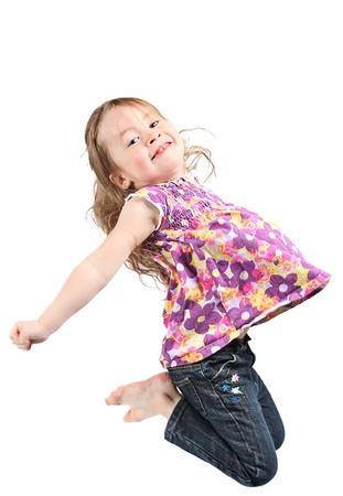 Adorable and happy little girl jumping in air. isolated on white background Фото со стока - 9540607