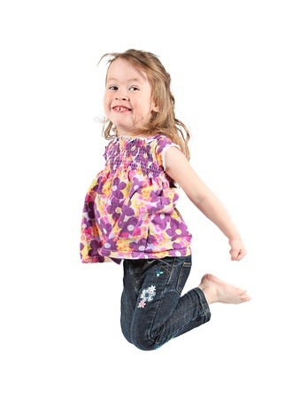 Adorable and happy little girl jumping in air. isolated on white background Фото со стока - 9540581