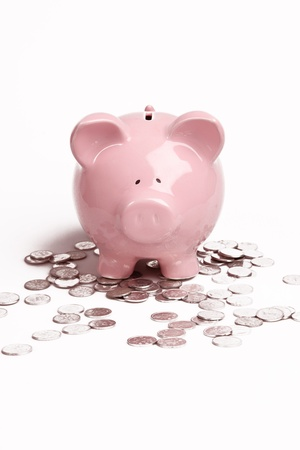 Pink Piggy Bank on isolated on white background with coins Banco de Imagens - 9540639