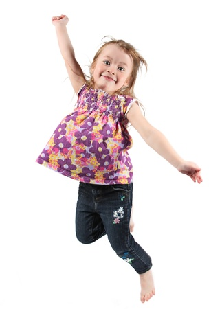 Adorable and happy little girl jumping in air. isolated on white background Stock Photo