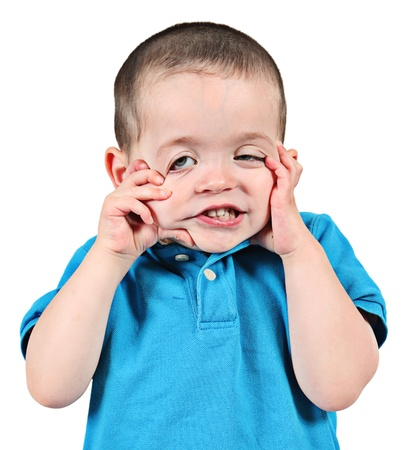 Cute little boy posing for camera on white background photo