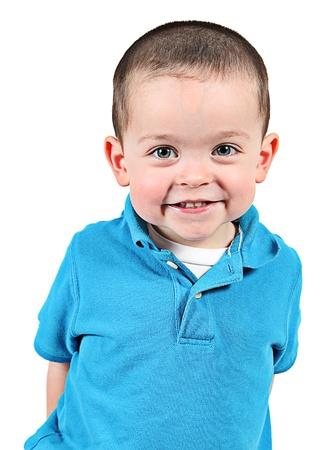 Schattige kleine jongen poseren voor de camera op een witte achtergrond Stockfoto