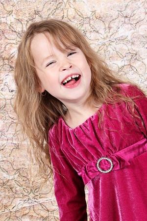 velvet dress: Little Girl Laughing with her christmas dress on