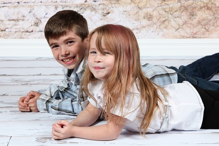 Boy and Girl together on wooden floor photo
