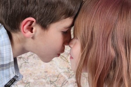 Boy and girl kissing each other taken closeup photo