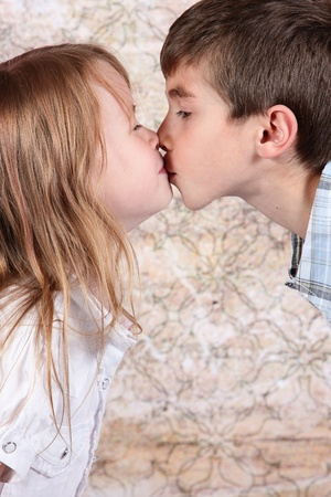 woman profile: boy and girl kissing each other - closeup
