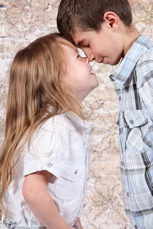 Boy and girl together with noses touching photo