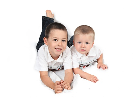 Brothers standing together back to back on white Stock Photo - 12010361