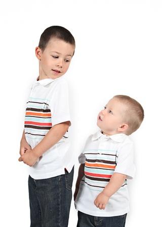 shorter: Little boy posing with smile on white