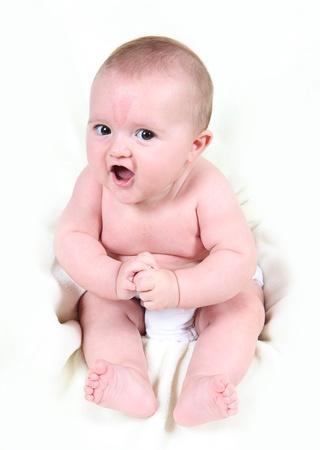 Little baby girl taken on white background
