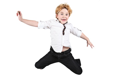 Cute little boy jumping in air on white background photo
