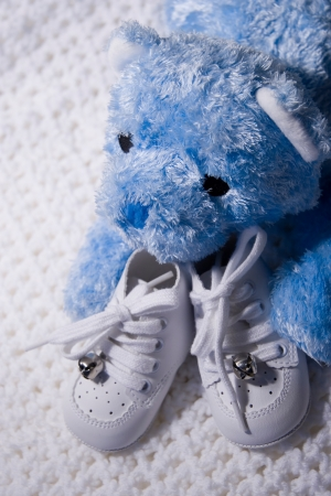 Pair of Babies shoes with Teddy Bear photo