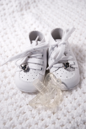 Pair of Babies first shoes with pacifier