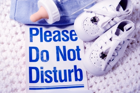 Baby stuff with a please do not disturb sign photo
