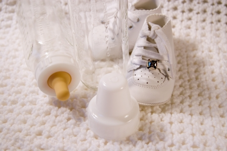 Pair of Babies shoes with Bottles