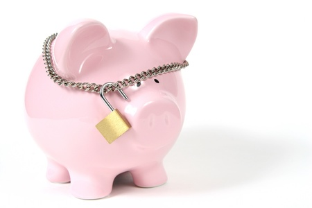 locked: Pink Piggy Bank on isoalted on white background with lock Stock Photo