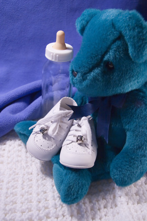 Babies shoes, Teddy Bear and Bottle photo