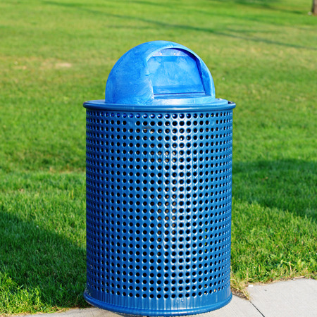 Blue Trash Can in park photo