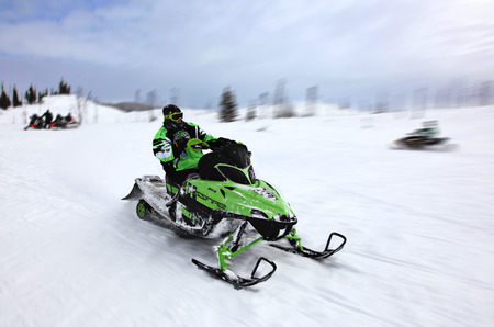 Man riding snowmobile in winter