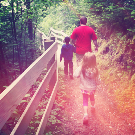 Family hiking in the woods - With Instagram effect 免版税图像