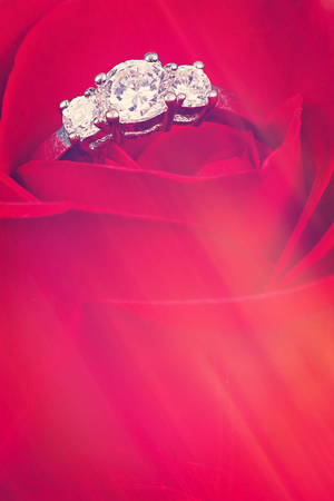 wedding ring with red background - With Instagram effect Stock Photo