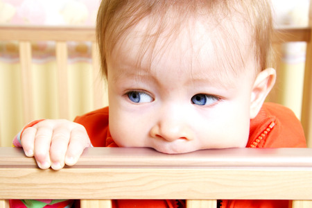 generration: Little Baby Bitting on crib Stock Photo