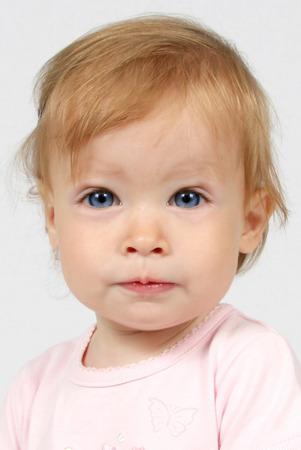 Little Baby Girl in pink dress taken closeup Reklamní fotografie