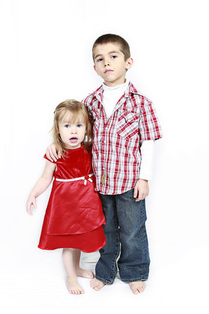 Adorable little brother and Sister on studio background photo