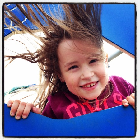 wind blown hair: Young girl having hair blown by wind Stock Photo