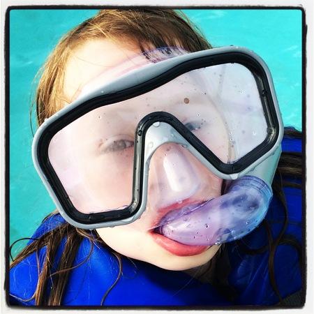 snorkling: Child practising snorkling Stock Photo