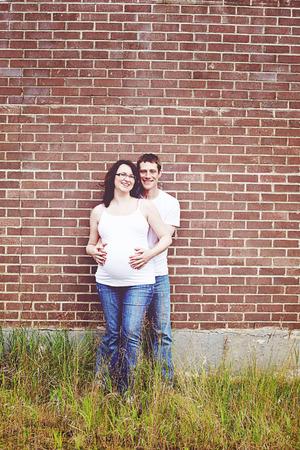 pregant females: Pregnant woman at 8 months in studio Stock Photo