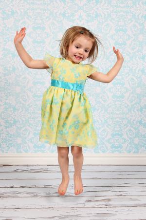 Beautiful Little Girl Posing for Camera in Studio photo