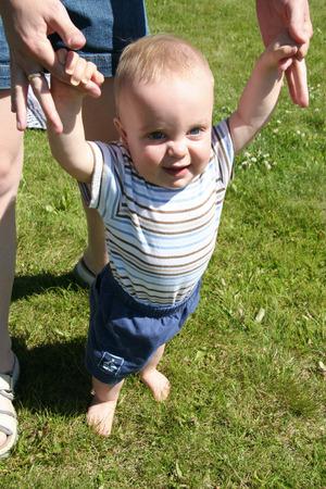 fingers: Holding moms fingers Stock Photo