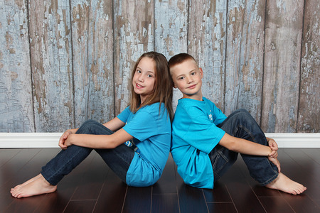 twin sister: Twin brother and sister posing together in studio