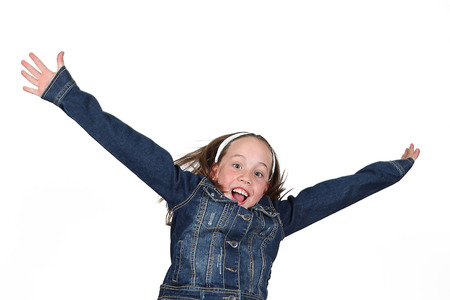Beautiful young girl jumping in air on white background photo